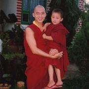 H.E. Tsem Tulku Rinpoche holding the present incarnation of H.H. Zong Rinpoche in Gaden Shartse Monastery
