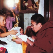 H.E. Tsem Tulku Rinpoche meeting his guru Kyabje Zong Rinpoche's incarnation for the first time and making offering of a Manjushri statue to him in Gaden Monastery