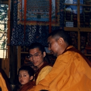 The present incarnation of H.H. Zong Rinpoche sitting on H.E. Tsem Tulku Rinpoche's lap, together they were attending a Dharma teaching by H.H. the Dalai Lama in Dharamsala